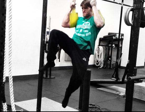 core-training-for-athletes-ab-strap-kicks