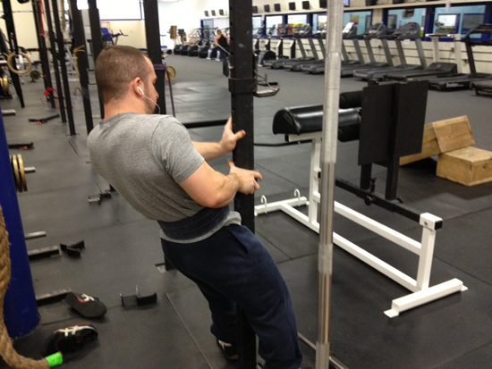 strength-training-for-athletes-using-cage-to-put-belt-on-small